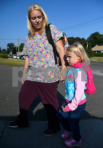 8/31/2017 Mike Orazzi | Staff Nicole Bonvisuto and her daughter Sedona arrive at the Stafford School for the first day of school in Bristol. Thursday.