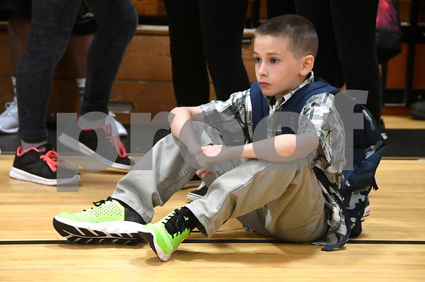 8/31/2017 Mike Orazzi | Staff Kaidyn Angraves waits in the gyn on the first day of school at the Eli Terry Middle School in Plymouth Wednesday.