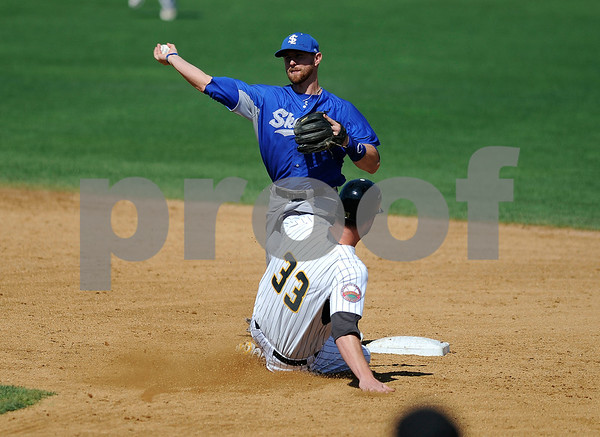8/31/2017 Mike Orazzi | Staff New Britain Bees' Jon Griffin (33) starts a double play at second with the Sugar Land Skeeters' Bryan Pounds (15) Wednesday morning.