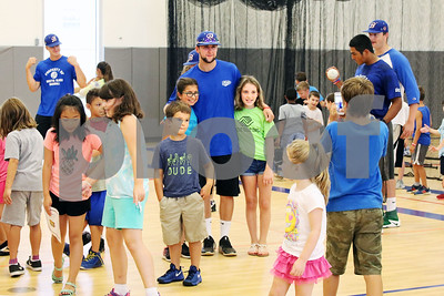 Bristol Blues player Mitch Guilmette poses with children at the Boys & Girls Club for a meet and greet. The event was organized by Briana Root and George Klimek.