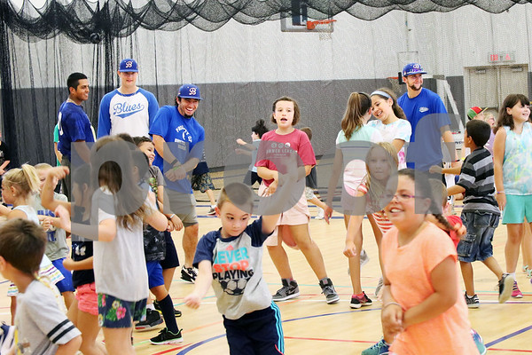 Players Jayson Gonzalez, Tyler Kovalewich, Chris Davis and Mitch Guilmette from the Bristol Blues visit children at the Boys & Girls Club for a meet and greet. The event was organized by Briana Root and George Klimek.