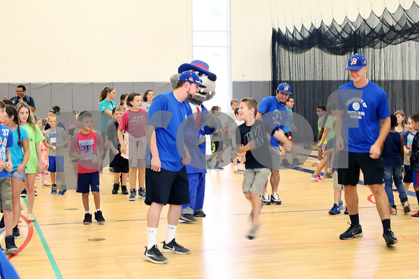 Players Chris Davis, Mitch Guilmette and Takoda Sitaon from the Bristol Blues visit children at the Boys & Girls Club for a meet and greet. The event was organized by Briana Root and George Klimek.