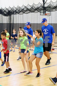 Players  Chris Davis and Mitch Guilmette of the Bristol Blues join children dancing at the Boys & Girls Club for a meet and greet. The event was organized by Briana Root and George Klimek.