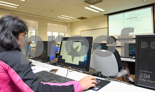 080317 Wesley Bunnell | Staff Sannati Choudhary, age 14, shows off her design titled fun spirals during a Programming Fun with Python class at CCSU on Friday afternoon. The program is part of CCSU's Office of Continuing Education summer program Tech it Out 2017.