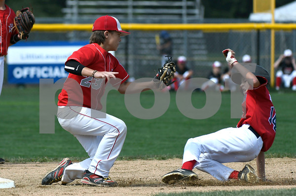 8/6/2017 Mike Orazzi | Staff New Jersey's Chris Cartnick (23) tags out the District of Columbia's Roland Hartman (14) at second base during the Eastern Regional Little League Tournament held at Breen Field in Bristol Sunday.