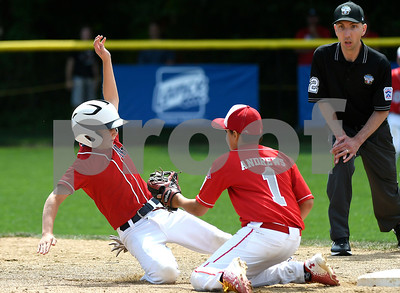 8/6/2017 Mike Orazzi | Staff New Jersey's Chris Andrews (1) as the District of Columbia's Clark Mocek (5) slides safely into second during the Eastern Regional Little League Tournament held at Breen Field in Bristol Sunday.