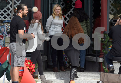 "8/8/2017 Mike Orazzi | Staff Melissa Joan Hart in front of the former Barley Vine on Main Street, that has been transformed into a toy store for the shooting of scenes for the upcoming movie ""Christmas Hours"", starring Mario Lopez and Melissa Joan Hart, is being shot mostly in New Britain with some scenes in Bristol."