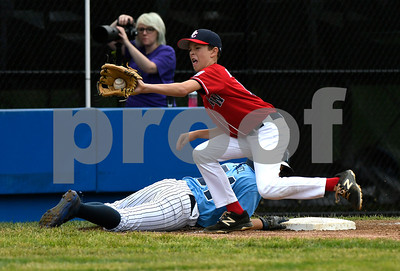 8/8/2017 Mike Orazzi | Staff Washington DC's Roland Hartman takes the throw as Maryland's Will Gisriel (54) dives back to third during the Eastern Regional Little League Tournament in Bristol Tuesday morning.