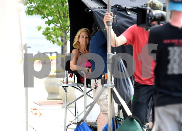 8/8/2017 Mike Orazzi | Staff Paula Hart sits in the shade in front of the former Barley Vine on Main Street, that has been transformed into a toy store for the shooting of scenes for the upcoming movie Christmas Hours&quote;, starring Mario Lopez and Melissa Joan Hart, is being shot mostly in New Britain with some scenes in Bristol.