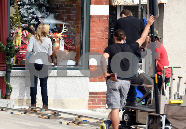 8/8/2017 Mike Orazzi | Staff Melissa Joan Hart in front of the former Barley Vine on Main Street, that has been transformed into a toy store for the shooting of scenes for the upcoming movie Christmas Hours&quote;, starring Mario Lopez and Melissa Joan Hart, is being shot mostly in New Britain with some scenes in Bristol.