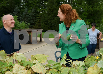 080817  Wesley Bunnell | Staff  Congresswoman Elizabeth Esty toured CCARC in New Britain on Tuesday afternoon speaking to workers and clients. CCARC provides services to support adults with intellectual disabilities and their families. Congresswoman Esty jokes around with Keith Font as the tours the outdoor garden.