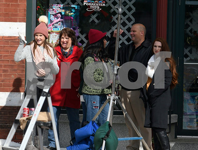 "8/8/2017 Mike Orazzi | Staff Actors in front of the former Barley Vine on Main Street, that has been transformed into a toy store for the shooting of scenes for the upcoming movie ""Christmas Hours"". ""Christmas Hours,"" starring Mario Lopez and Melissa Joan Hart, is being shot mostly in New Britain with some scenes in Bristol."