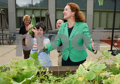 080817  Wesley Bunnell | Staff  Congresswoman Elizabeth Esty toured CCARC in New Britain on Tuesday afternoon speaking to workers and clients. CCARC provides services to support adults with intellectual disabilities and their families. Congresswoman Esty talks about growing zucchini as she tours the outdoor garden with Maria Duval.