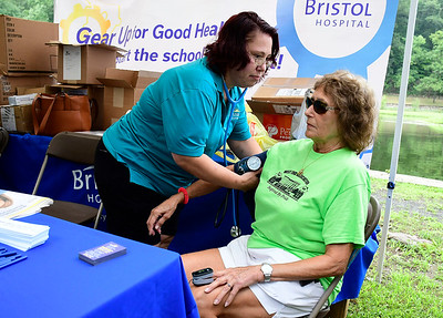8/18/2018 Mike Orazzi | Staff Bristol Hospital's Debbie Johnson checks Diane Budaj's blood pressure during the Bristol West End Association's seventh annual summer festival at Rockwell Park Saturday.