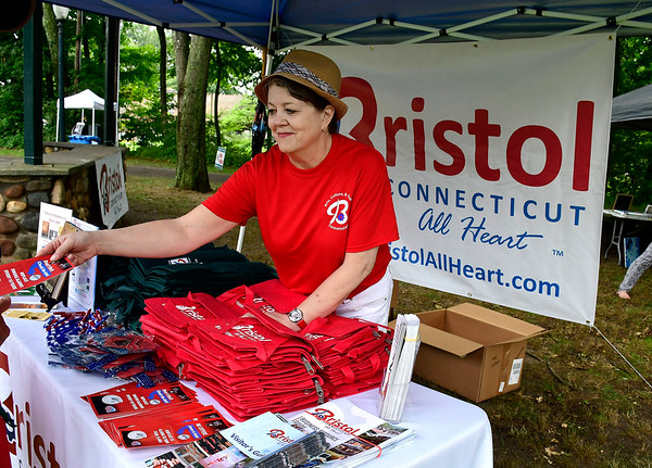 8/18/2018 Mike Orazzi | Staff Dawn Ledger passes out Bristol All Heart information during the Bristol West End Association's seventh annual summer festival at Rockwell Park Saturday.