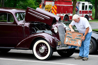 8/18/2018 Mike Orazzi | Staff Henry Russell sets up a display in front of his 1937 Chevy during the auto show at the Bristol West End Association's seventh annual summer festival at Rockwell Park Saturday.