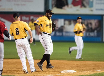08/20/18  Wesley Bunnell | Staff  The New Britain Bees defeated the Road Warriors 8-6 in Atlantic League Baseball at New Britain Stadium on Monday evening. Jason Rogers (14) fields a ball tags first base for the unassisted out.