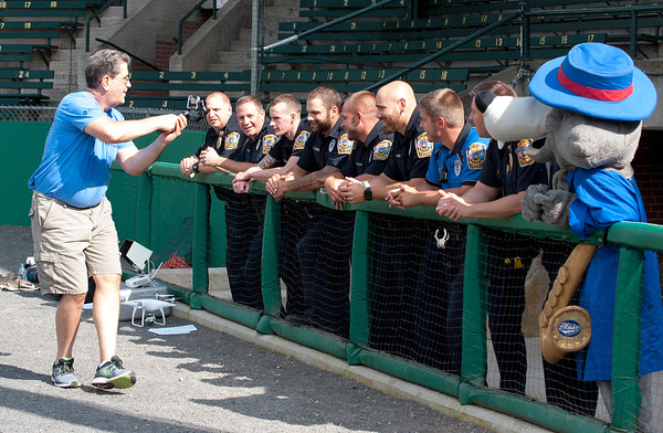 08/21/18 Wesley Bunnell | Staff Bristol first responders filmed portions of their lip sync challenge video at Muzzy Field on Tuesday afternoon before the Mayor's Pencil Hunt. Tom Mazzarella of Mazzarella Productions records as he walks down the line of first responders and the Bristol Blues mascot.