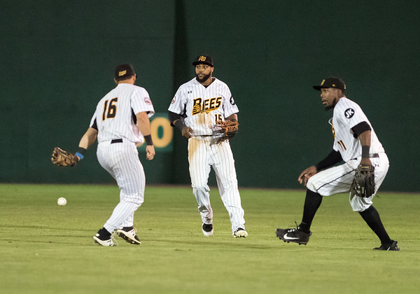 08/21/18 Wesley Bunnell | Staff The New Britain Bees vs the Road Warriors on Tuesday night at New Britain Stadium. The blooper to shallow right center falls between second baseman Vinny Siena (16), center fielder Darren Ford (15) and right fielder Jamar Walton (11).