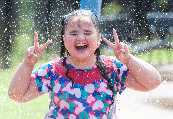 08/21/18 Wesley Bunnell | Staff Jaridel Burgos , age 8, smiles as she plays in the water at the Willow Street Splash Pad on Tuesday afternoon.