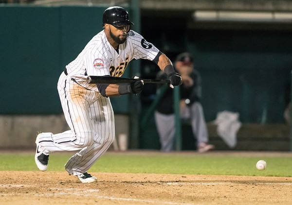 08/21/18 Wesley Bunnell | Staff The New Britain Bees vs the Road Warriors on Tuesday night at New Britain Stadium. Center fielder Darren Ford (15) with a bunt attempt.