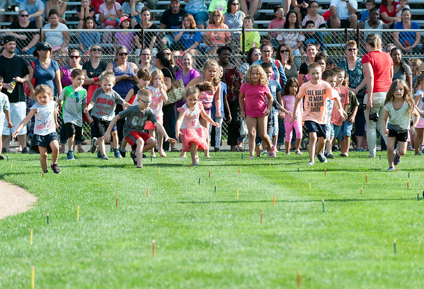 08/21/18 Wesley Bunnell | Staff Children in grades K-1 at the start of the 1st Annual Mayor's Back to School Pencil Hunt which took place at Muzzy Field on Tuesday afternoon. The event featured 500 children in age specific groups in grades K-8th searching for specific colored pencils on the field to win prizes.
