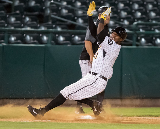 08/21/18 Wesley Bunnell | Staff The New Britain Bees vs the Road Warriors on Tuesday night at New Britain Stadium. Jamar Walton (11) hits a triple and slips as he runs into third base.