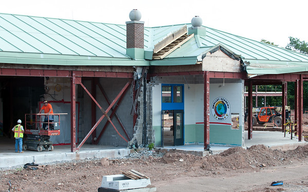 08/21/18 Wesley Bunnell | Staff The painting welcoming visitors to Smalley Academy in the main entrance can be seen amid the construction on Tuesday afternoon.