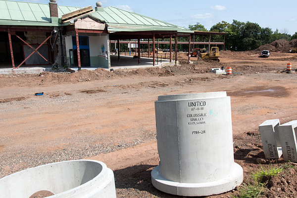 08/21/18 Wesley Bunnell | Staff Construction materials bearing the inscription for Smalley Elementary sit across from the main entrance on Talcott St on Tuesday afternoon.