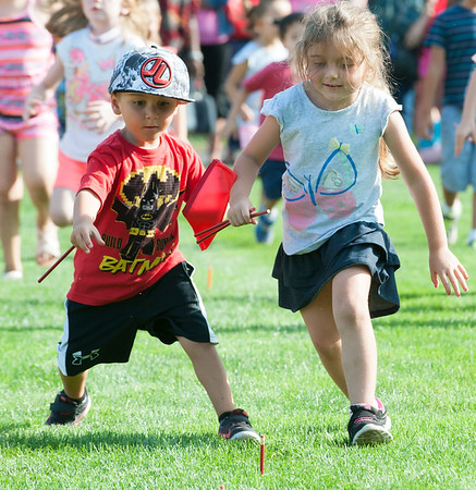 08/21/18 Wesley Bunnell | Staff Carter Crisco, L age 5, and Kylie Serra, age 6, both take aim at a red pencil during the 1st Annual Mayor's Back to School Pencil Hunt at Muzzy Field on Tuesday afternoon. The event featured 500 children in age specific groups in grades K-8th searching for specific colored pencils on the field to win prizes.