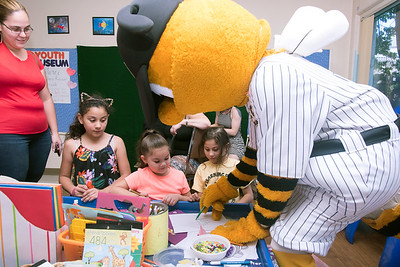 08/23/18  Wesley Bunnell | Staff  The New Britain Youth Museum held a back to school party featuring activities, prizes and New Britain Bees mascot Sting on Thursday afternoon.  Priscilla Quiles, age 4 middle, plays Tic Tac Toe! with Bees mascot Sting as Amariah Baez, 2nd L age 9, and Leilani Baez, age 7, look on.