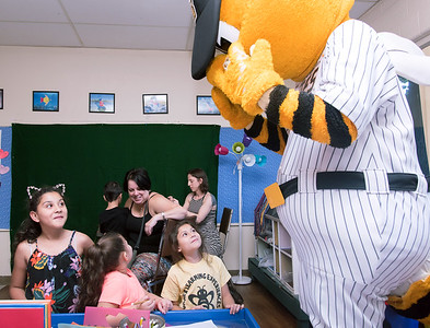 08/23/18  Wesley Bunnell | Staff  The New Britain Youth Museum held a back to school party featuring activities, prizes and New Britain Bees mascot Sting on Thursday afternoon.  Bees mascot Sting covers his face after losing to Tic Tac Toe! agasint Priscilla Quiles, age 4 middle, as Amariah Baez, L age 9, and Leilani Baez, age 7, look up. .