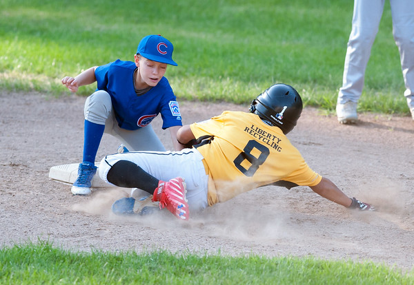 08/23/18 Wesley Bunnell | Staff The Forestville Pirates vs the Edgewood Cubs in the Bristol Little League City Series on Thursday evening at Frazier Field. The Cubs short stop Gabriel White (3) tags out the Pirates Aiden Lopez (8) on an attempted steal.