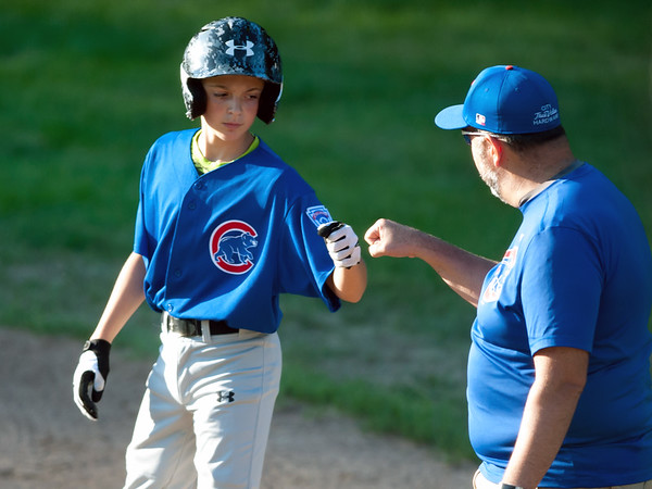 08/23/18 Wesley Bunnell | Staff The Forestville Pirates vs the Edgewood Cubs in the Bristol Little League City Series on Thursday evening at Frazier Field. Cubs Isaac Roberge (15) fist bumps the first base coach after a base hit.