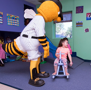 08/23/18  Wesley Bunnell | Staff  The New Britain Youth Museum held a back to school party featuring activities, prizes and New Britain Bees mascot Sting on Thursday afternoon. Bees mascot Sting plays along with Priscilla Quiles, age 4.