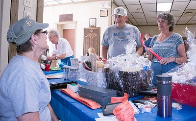08/23/18  Wesley Bunnell | Staff  Retired police and firefighters held their annual dinner at American Legion Post 2 on Thursday evening. Darlene Coffey runs the raffle table as she talks with guests Joe and Donna Fusco.