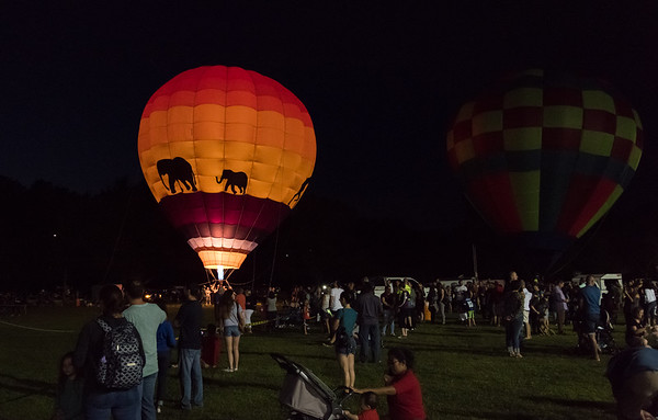 08/24/18 Wesley Bunnell | Staff Balloons give tethered rides to passengers at the Plainville Balloon Festival on Friday night.