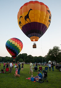 08/24/18  Wesley Bunnell | Staff  Balloons give tethered rides to passengers at the Plainville Balloon Festival on Friday evening.