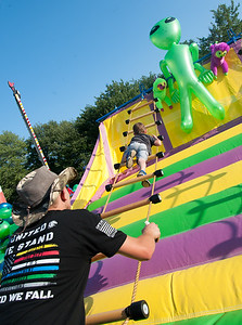 08/24/18  Wesley Bunnell | Staff  Ethan Pelletier, age 4, attempt to climb the rope ladder as worker Mark Owen holds the base at the Terryville Fair on Friday.