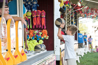 08/24/18  Wesley Bunnell | Staff  Landin Boutot, age 11, plays a basketball game on Friday the opening day of the Terryville Carnival.