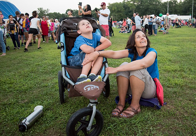 08/24/18  Wesley Bunnell | Staff  Jake Cafiero, age 7, looks up at his older brother riding in a hot air balloon along with is mother Stacey Calfiero at the Plainville Balloon festival on Friday night.