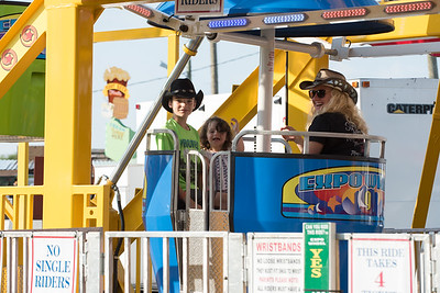 08/24/18  Wesley Bunnell | Staff  Shawn Alexander Jr ,age 13, rides down the Ferris Wheel next to Emilie Torneo, age 4, and Carissa Torneo on the opening Day of the Terryville Carnival on Friday.