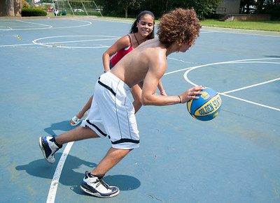 08/27/18  Wesley Bunnell | Staff  Mileynie Melendez guards Raymond Ward in a friendly game of pick up basketball at Page Park on Monday afternoon.