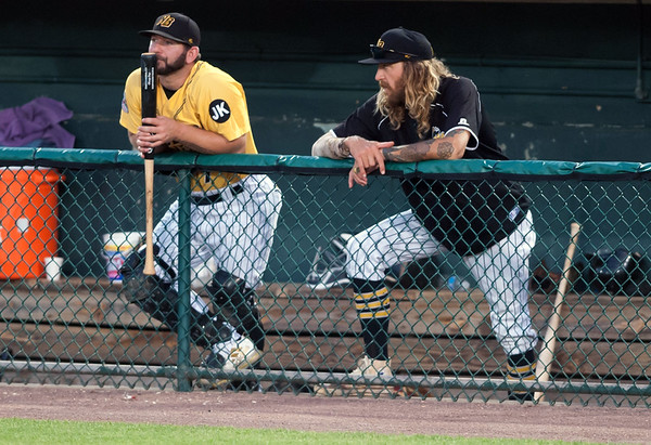 08/28/18 Wesley Bunnell | Staff The New Britain Bees vs the York Revolution on Tuesday night at new Britain Stadium. Ryan Wagner (7) , L, stands next to Mark Hamburger (5) in the Bees dugout.