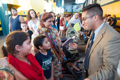 08/28/18  Wesley Bunnell | Staff  Lincoln Elementary School Principal Vice Principal Orlando Ruiz, R, greet students Amna Iqbal, age 9 L, and Janveer Iqbal, age 7, and their mother Ishral Iqbal at the CSDNB annual Back to School Bash on Tuesday evening at New Britain Stadium prior to the New Britain Bees game vs the York Revolution. The bash helps introduce students to school staff prior to the school year as well as free admission to the Bees baseball game. Lincoln Elementary School Principal Lisa Torres, middle, and Vice Principal Orlando Ruiz, R, greet students at the
