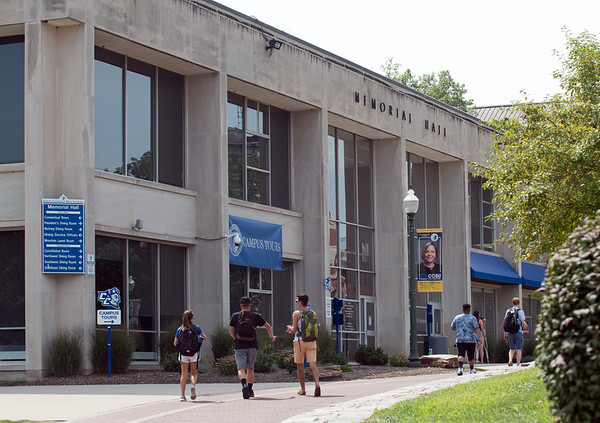 08/28/18 Wesley Bunnell | Staff CCSU students walk outside of Memorial Hall on the first day of school for the fall semester on Tuesday afternoon.