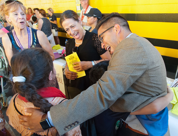 08/28/18 Wesley Bunnell | Staff Lincoln Elementary School Principal Lisa Torres, middle, and Vice Principal Orlando Ruiz, R, greet students at the CSDNB annual Back to School Bash on Tuesday evening at New Britain Stadium prior to the New Britain Bees game vs the York Revolution. The bash helps introduce students to school staff prior to the school year as well as free admission to the Bees baseball game. Lincoln Elementary School Principal Lisa Torres, middle, and Vice Principal Orlando Ruiz, R, greet students at the