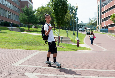 08/28/18  Wesley Bunnell | Staff  A skateboarder skates towards the student center at CCSU on the first day of school for the fall semester on Tuesday afternoon.