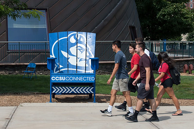 08/28/18  Wesley Bunnell | Staff  CCSU students walk past an oversize lawn chair outside of the Student Center on the first day of school for the fall semester on Tuesday afternoon.