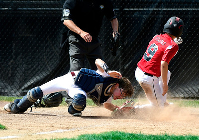 8/10/2018 Mike Orazzi | Staff New Hampshire's Braeden Lambert (11) applies the late tag as Rhode Island's Dylan Mourao (9) scores the game winning run in the bottom of the 6th during the Eastern Regional Little League Tournament at Breen Field in Bristol Friday.